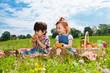 Two children sitting on picnic