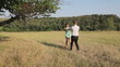 Man and woman dancing in the field