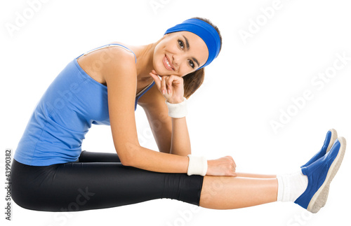 Cheerful smiling woman exercising, over white