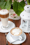Coffee latte and cappuccino cafeteria garden table