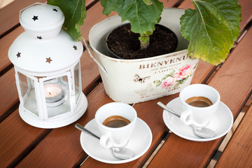 Two cups of espresso coffee cafeteria garden table