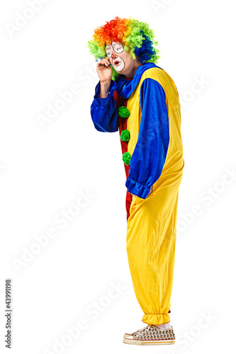 Portrait of a crying clown over white background