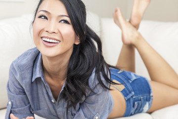 Beautiful Sexy Chinese Oriental Asian Woman Smiling in Shorts