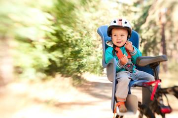 Little boy in bike child seat