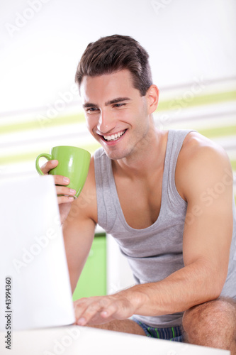 Handsome young men with laptop