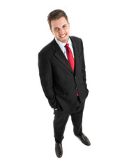 Full length businessman looking up