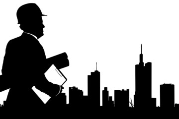 Silhouette of male engineer looking at buildings