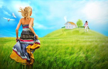 Young woman running across field to house and family of her drea