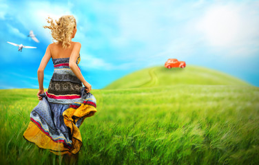 Young woman running across the field to the car on a hill. Dream
