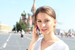 woman talking on the phone in Moscow near the Kremlin