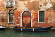 Ancient brick building on a canal in Venice.