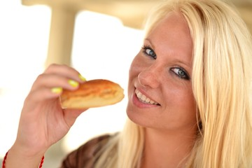 young woman eating a cake