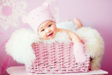 Fototapety newborn baby girl in pink knitted bear hat