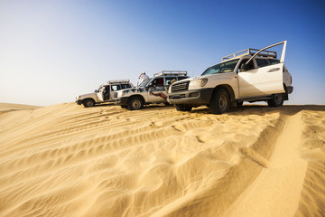 4x4 vehicles on a dune in the Sahara Desert, Tunisia