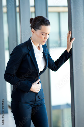 young businesswoman having period pain