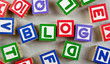 Wooden blocks forming the word BLOG in the center