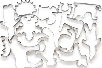 A view looking down on many cookie cutters isolated on white bac