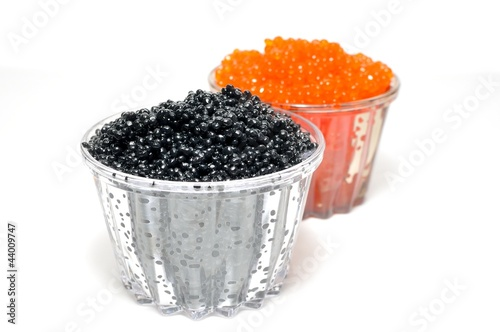 Red and black caviar in glass