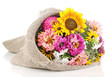 Beautiful bouquet of bright flowers in sacking isolated on