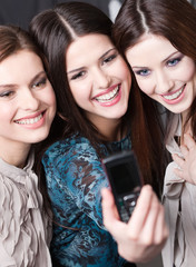Photo session of three young women with dark hair