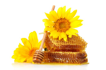 sweet honeycombs with honey, wooden drizzler and sunflowers,