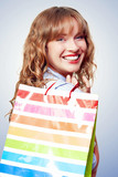 Happy female retail shopper with bag and smile