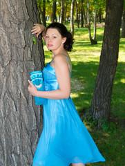 A beautiful woman in a blue dress