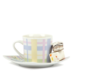Coffee cup with sweets