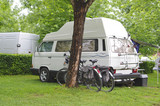 camper and bicycles on a camping site