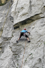 Male rock-climber on a granite wall