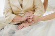 Bride's and her mother's hands