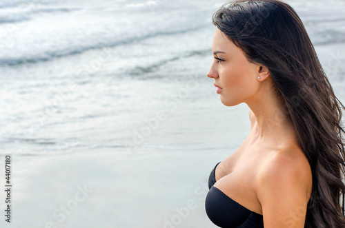 Beautiful girl looking at the sea