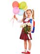 Schoolchild with flower.