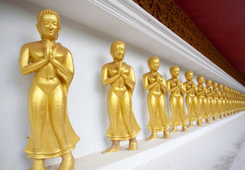 Buddha disciples on white wall