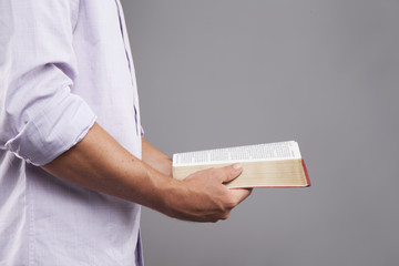 Profile of Hands holding Bible