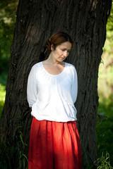 Sad woman in red sarafan