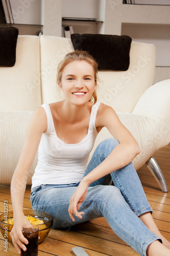 smiling teenage girl with remote control
