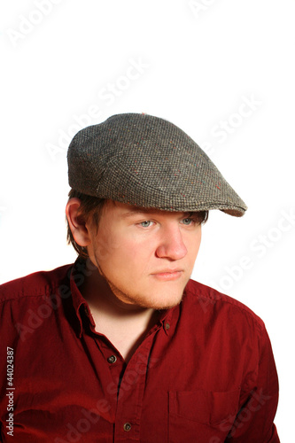 Serious Teen Boy Wearing A Flat Cap