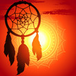 dream catcher, silhouette of a feather on a background sunset