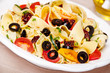 Pappardelle pasta with cherry tomatoes, olives and zucchini