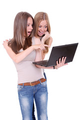 Two beautiful girls with laptop