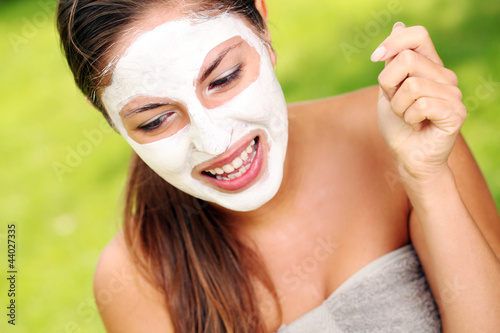 Woman with spa mask on her face