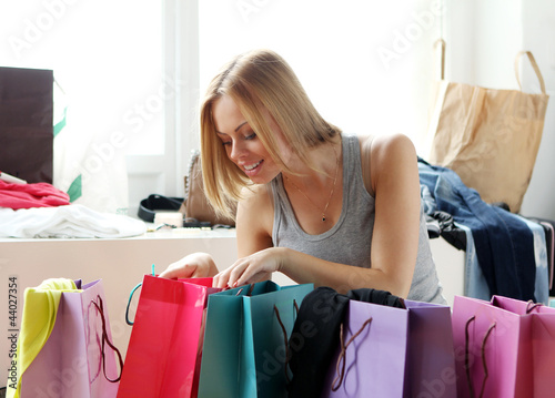 Woman looking into shopping bags