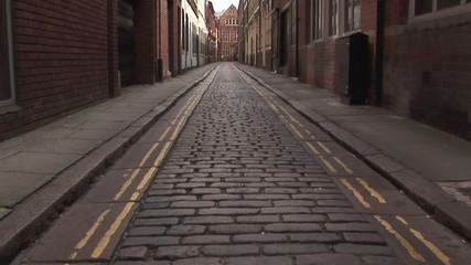 British vintage brick road with empty sidewalks