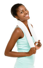 Attractive African American woman holding gym towel white backgr