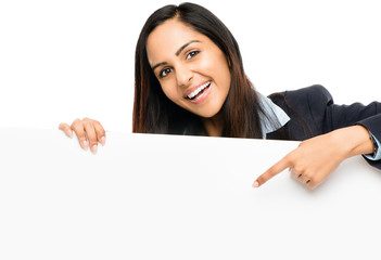 Portrait of attractive young indian woman holding billboard on w