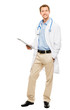 Full length of confident young doctor holding clipboard on white