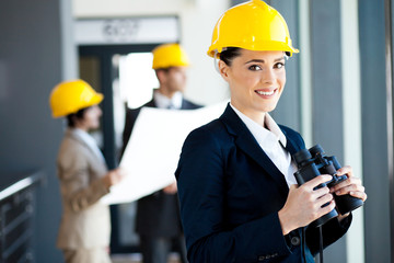 female construction manager with binoculars