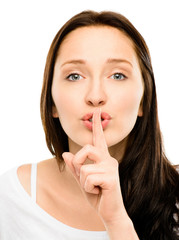 Woman with finger on lips closeup isolated on white background