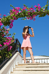 Young woman  with camera recorder on holidays